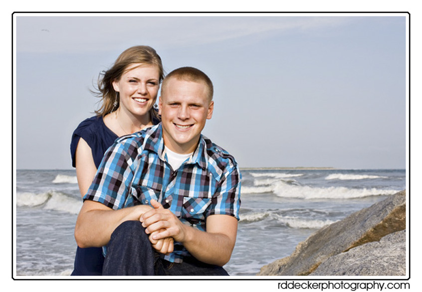 A couple poses for a portrait along a popular Crystal Coast beach.
