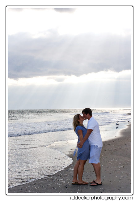 A romantic moment at sunset on the beach.