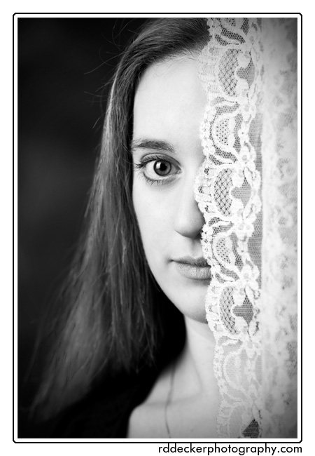 A less radical crop of Casey behind lace taken at my Newport, NC photography studio.