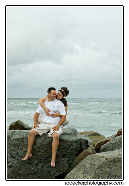 A moody day on a North Carolina beach makes for an interesting engagement photo session.