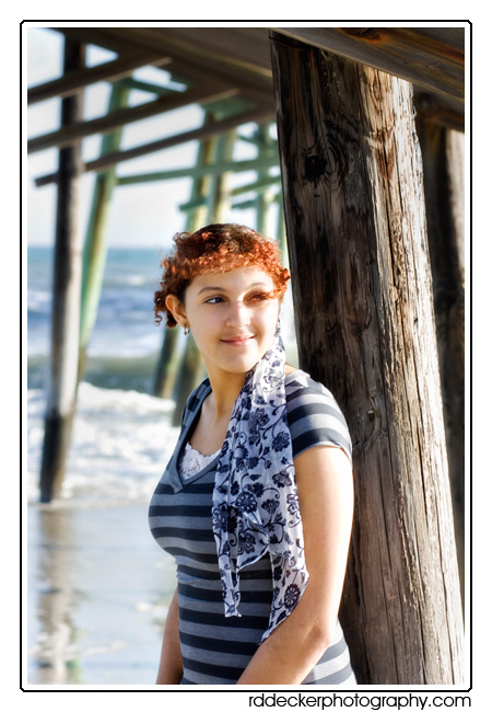 Fishing piers make a great backdrop for beach portraits.